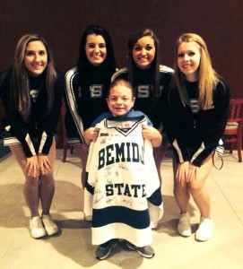 BSU cheerleaders present Nick with a signed BSU hockey jersey.