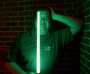 Theatre technician, Tom Skime, tests out the lightsabers, a major prop at the Headwaters Film Festival this year.