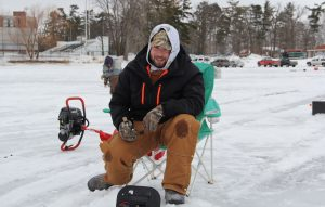 Brandon Koehnle from Rush City, Minnesota heard about the Beaver Freeze Ice Fishing Tournament from his roommate. He hopes to hold bragging rights over his buddy by catching the biggest fish. Photo by Shawn Campbell.