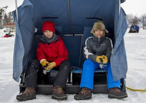 Brothers Casey Hiller and Zane Hiller brave the cold in hopes of winning the Beaver Freeze Ice Fishing Tournament. Photo by Shawn Campbell.