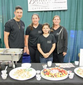 The Baker family (from left to right: Ryan, Tarynn, James and Jess) pose in front of their catering booth at the Bridal Expo. Baker's Place Catering is a family owned and operated business that Ryan and Jess started 13 years ago. This is their fifth year participating at the Bemidji Bridal Expo and their only means of self-promotion.