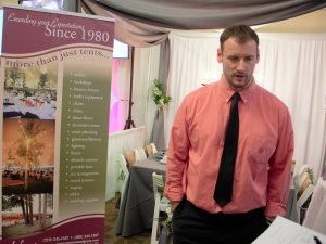Pat Kane explains to a customer what his business Lefty's Tent and Party Rental has to offer for a wedding day. Lefty's Tent and Party Rental has been around for 37 years and 2017 marks the tenth year that they have been participating in bridal showers throughout Minnesota, North Dakota, South Dakota and Wisconsin.